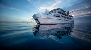 Liveaboard spend the night on the Great Barrier Reef.